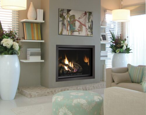 "Fireplace Xtrordinair 864 Clean Face Gas Fireplace with 2"" Trim Kit and Black Enamel Fireback in Living Room"